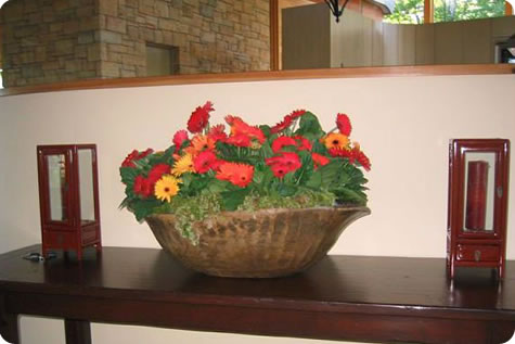 An overflowing bowl of flowers arranged by the Bondville Bloomist, bringing the colors of nature indoors